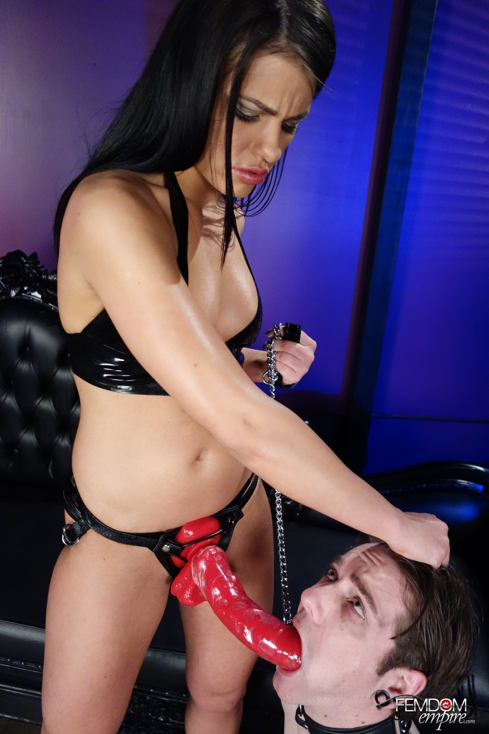 Mistress Adriana Chechik bends her marionette over and takes his caboose with her strapon knob.