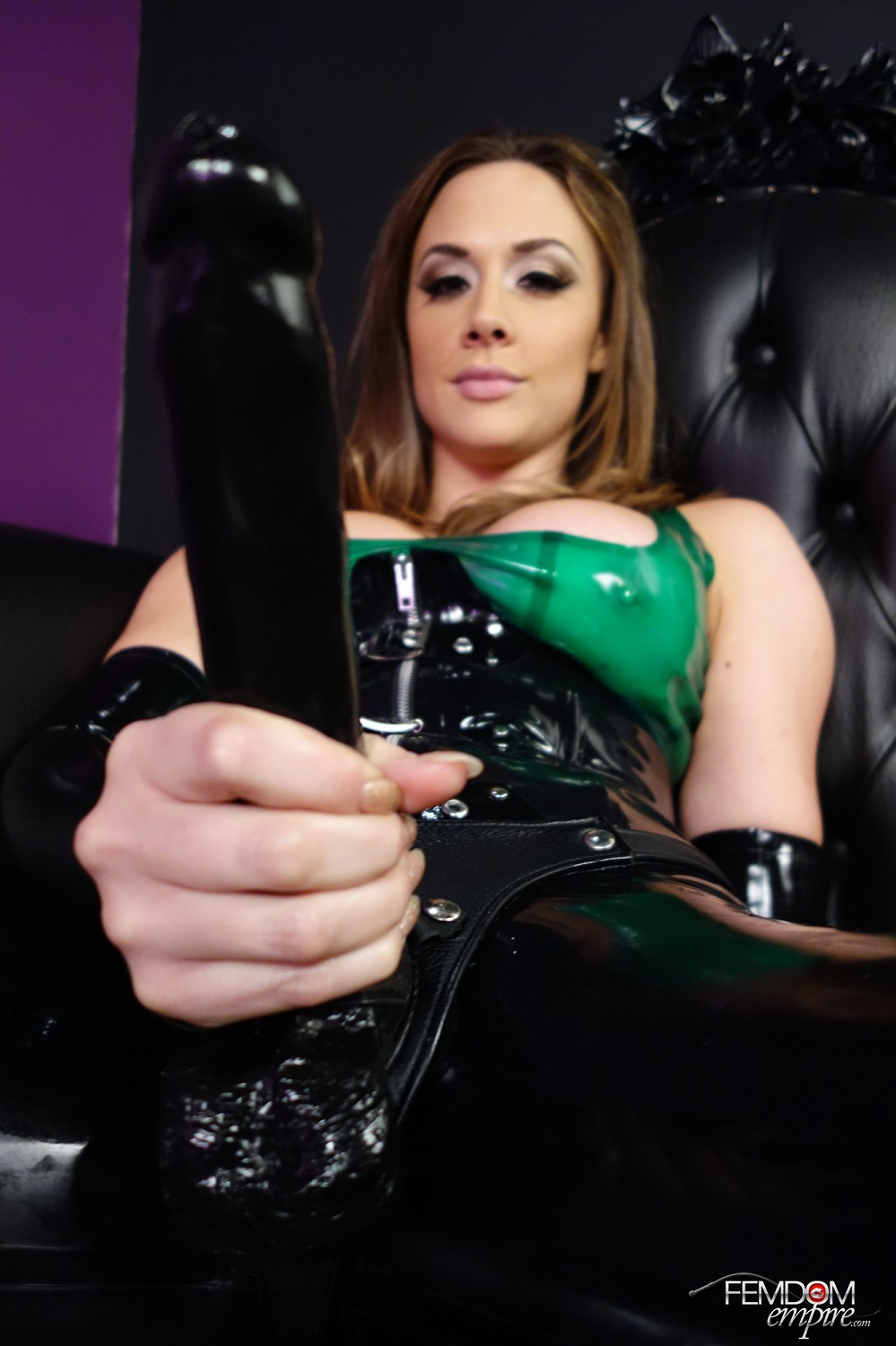 Mistress Chanel Preston puts her sub on a chain leash and makes him submit to her strap dildo hard-on.