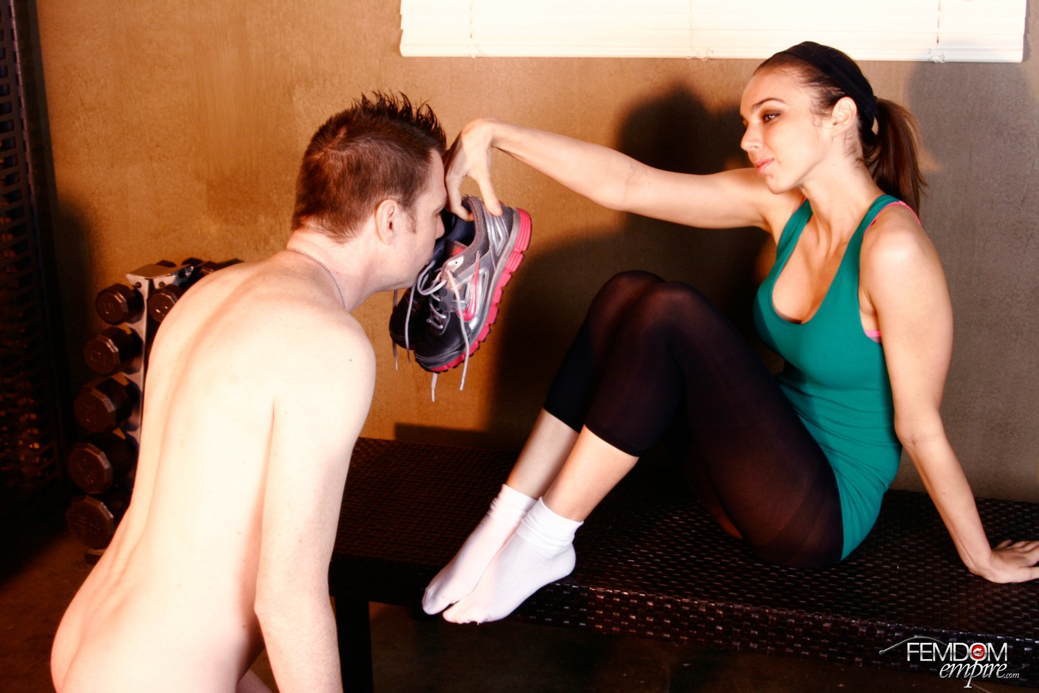 Domina Tiffany likes making her marionette worship her odorous and sweat-soaked workout boots, socks, and soles.