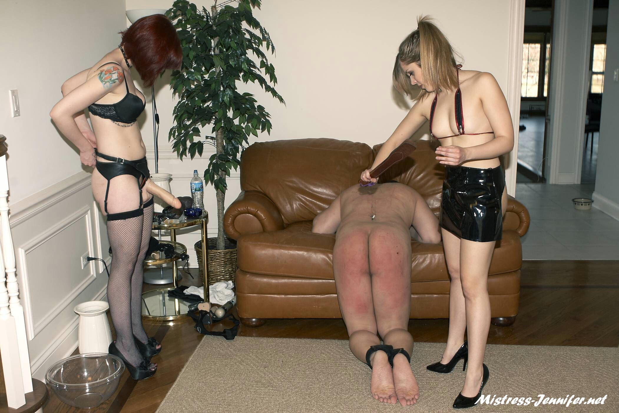 Dual Dominatrix tag squad strap on dildo and bashing