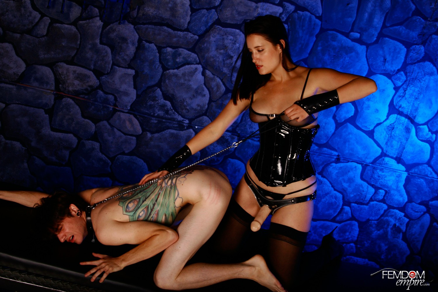 Domina Kimberly Kane makes her marionette submit to her strapon.